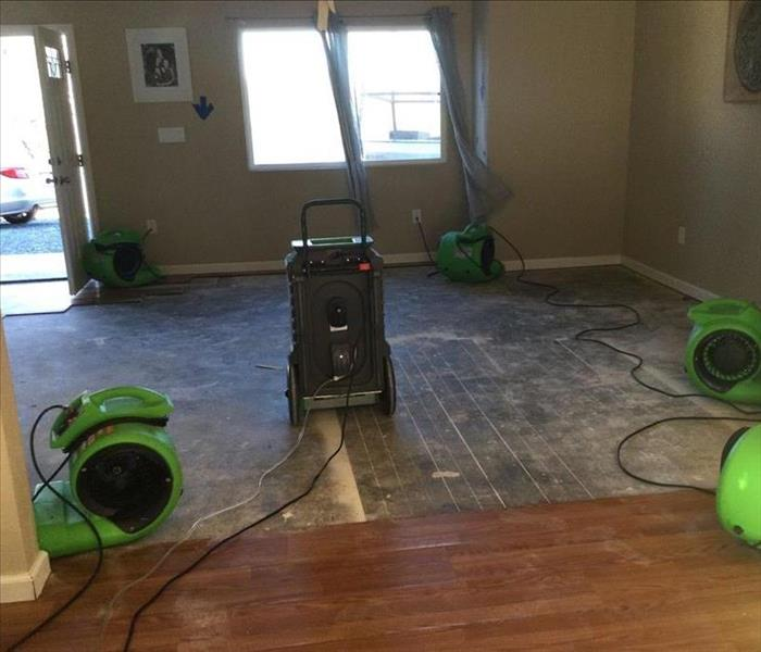 no laminate flooring, concrete, open space, with drying machine