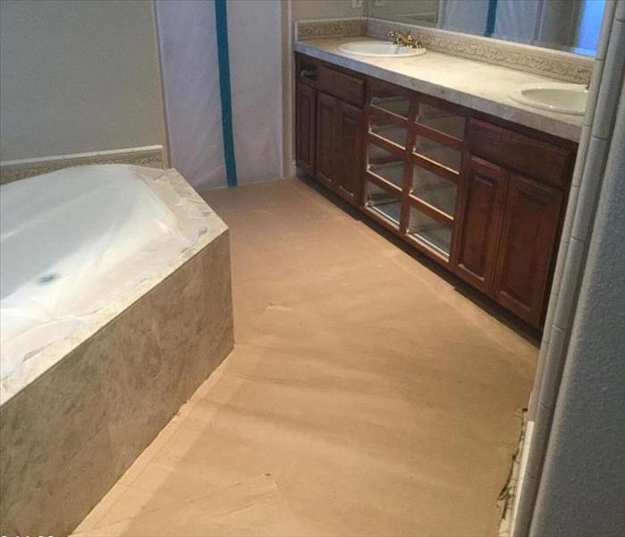 Bathroom with floors protected with cardboard