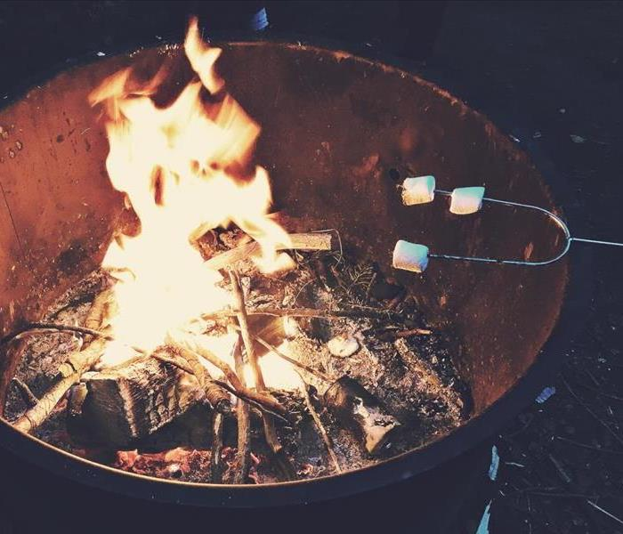 Fire pit with marshmallows roasting over it