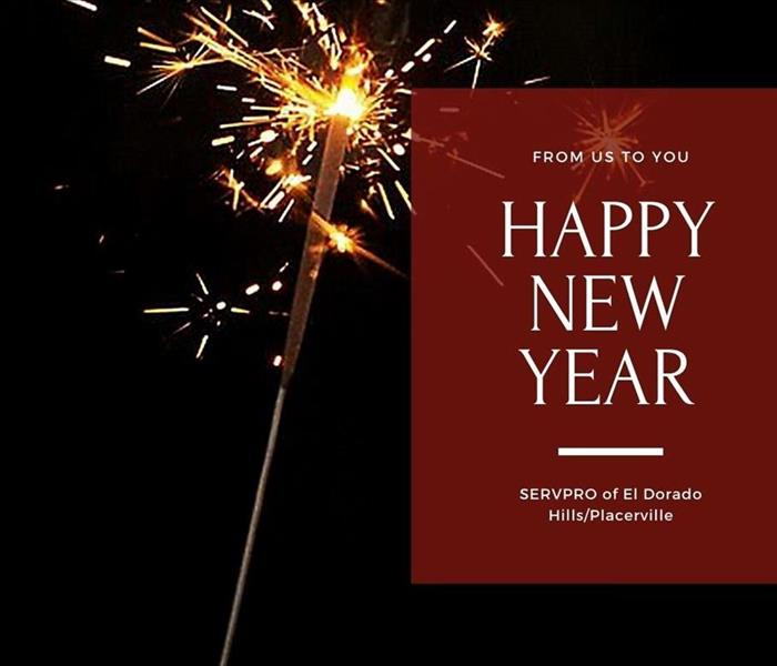 sparkler on black background with text in red box saying from us to you happy new year servpro of el dorado hills/placerville